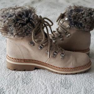 Tan Sam Edelman winter boots with faux fur trim.